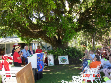 An auction in the gardens of the Panamonte Inn for a local charity