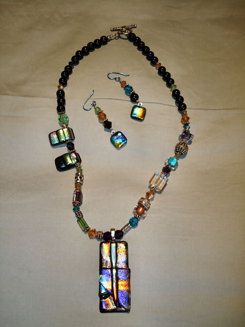 Black fused glass with silver and glass beads