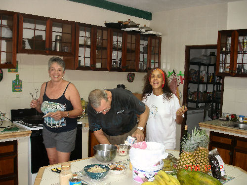 Fixing breakfast during a visit to Portobelo