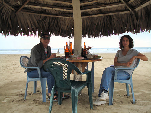 Mary Ann and me lunching on the beach in Olon