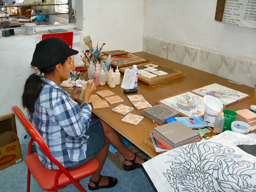 Local woman helps produce the tiles at Tucan Tiles