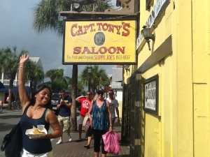 Key West...original Sloppy Joe's where Hemingway really hung out....no, not the cute young girl on the left...me under the sign