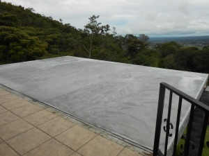Original new concrete deck terrace overlooking mountain.