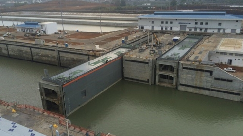 Giant rolling gates open the locks to level the water under the ships