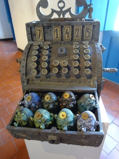 An old fashioned cash register with little egg people...all made of ceramic
