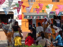 American Indians dance in the street of San Miguel